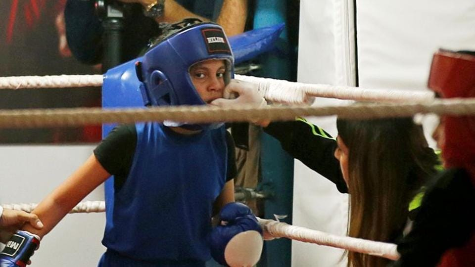 A Palestinian girl takes part in a rare boxing championship in Gaza City.