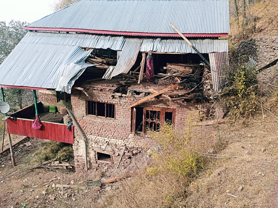 A house damaged in a ceasefire violation at Naugam Sector in Kashmir on November 13.