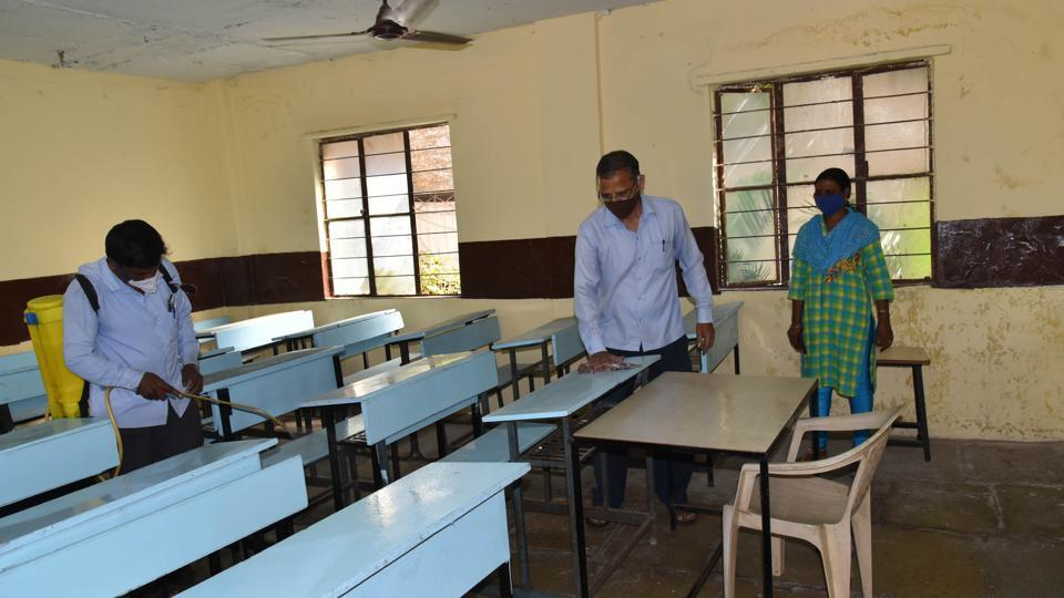 Staff monitoring the sanitisation measures at New English School, Bijlinagar, Chinchwad, on November 20. While decision to hold reopening of the civic-run and private schools till December 13 was taken by PMC on Saturday, schools from rural parts of Pune district will reopen on Monday as decided earlier.