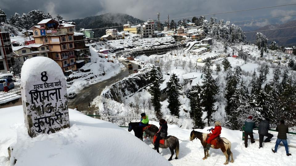 Tourists seen at Kufri after a fresh spell of snowfall in Shimla on November 20. According to scientists, the onset of winter, which usually takes place around mid-December, seems to be happening earlier due to the influence of back-to-back western disturbances, HT reported. (Deepak Sansta / HT Photo)