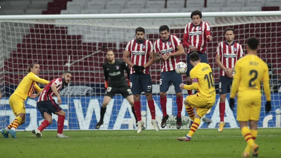 Barcelona's Lionel Messi takes a free kick during the Spanish La Liga soccer match between Atletico Madrid and FC Barcelona at the Wanda Metropolitano stadium in Madrid.
