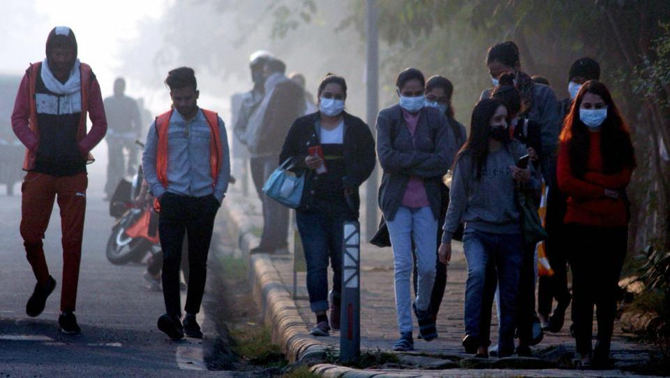 Commuters seen wearing warm clothes on a cold winter morning in Gurugram on November 20. In the plains, towns such as Hisar in Haryana, Churu in Rajasthan and Adampur in Punjab, too, recorded minimum temperatures that were 4-5 degrees below normal on November 20.  (PTI)