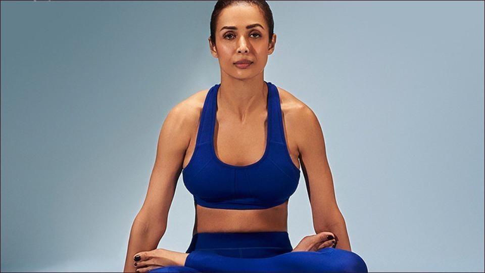 Malaika Arora pushes fans towards a fit lifestyle with Yoga challenge Tulasana or hand-balancing asana