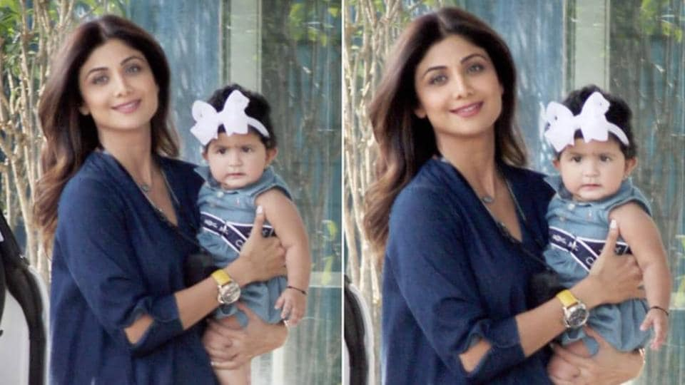 Shilpa Shetty poses with daughter Samisha, the little one is baffled by all the attention. See cute pics