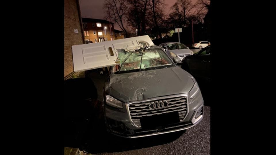 The image shows the Audi with the smashed windshield.