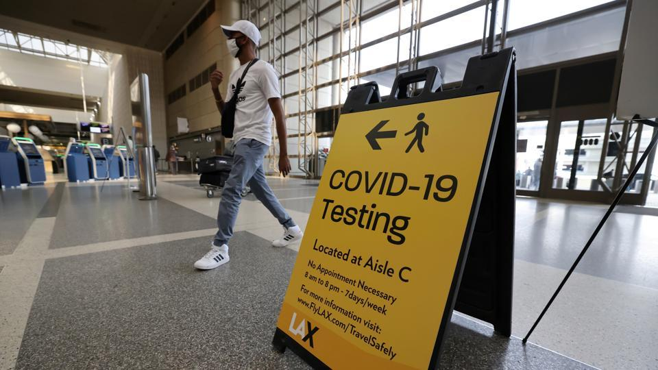Defying warnings, millions in US travel for Thanksgiving amid raging Covid-19