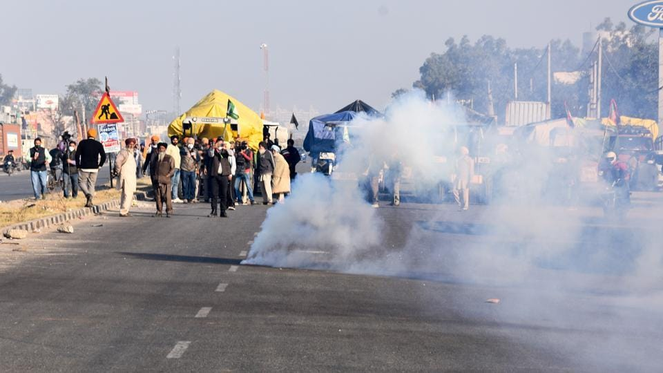 Tear gas projectiles fired by Delhi police land near protesting farmers as they tried to cross the border into Delhi, at the Singhu border in New Delhi on November 27.