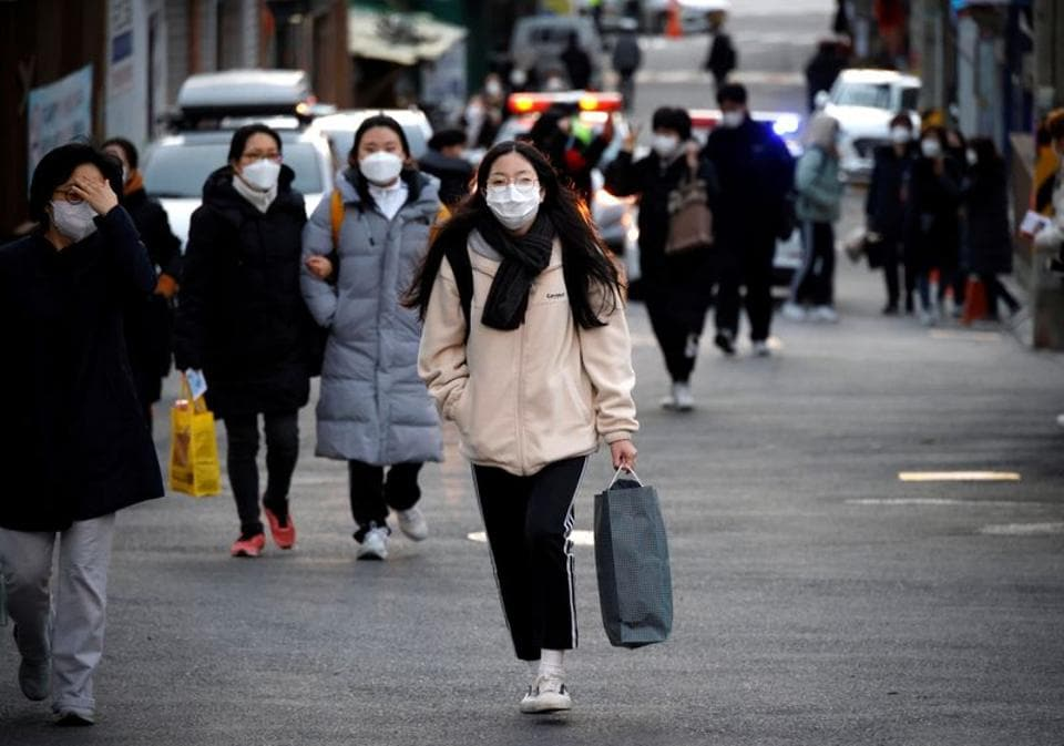 South Korea clamps down as virus cases surge to nine-month high