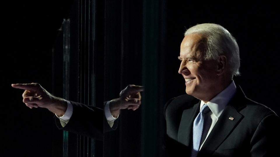 Joe Biden points a finger at an election rally after news media announced that he has won the 2020 US presidential election, in Wilmington, Delaware, on November 7.