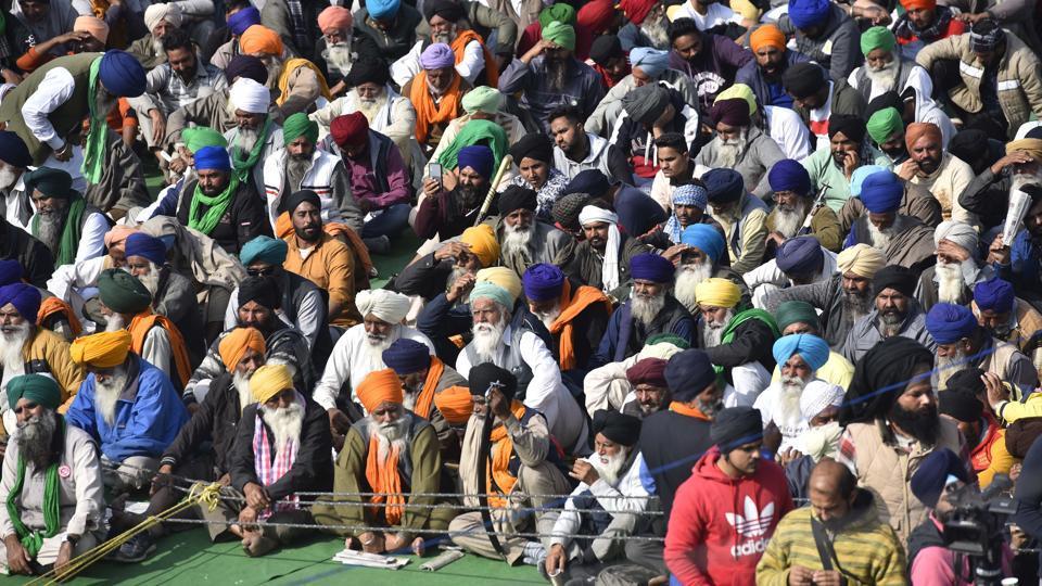 Farmers congregate during a protest against the new farm laws at Singhu (Delhi-Haryana Border) near New Delhi  on Monday.