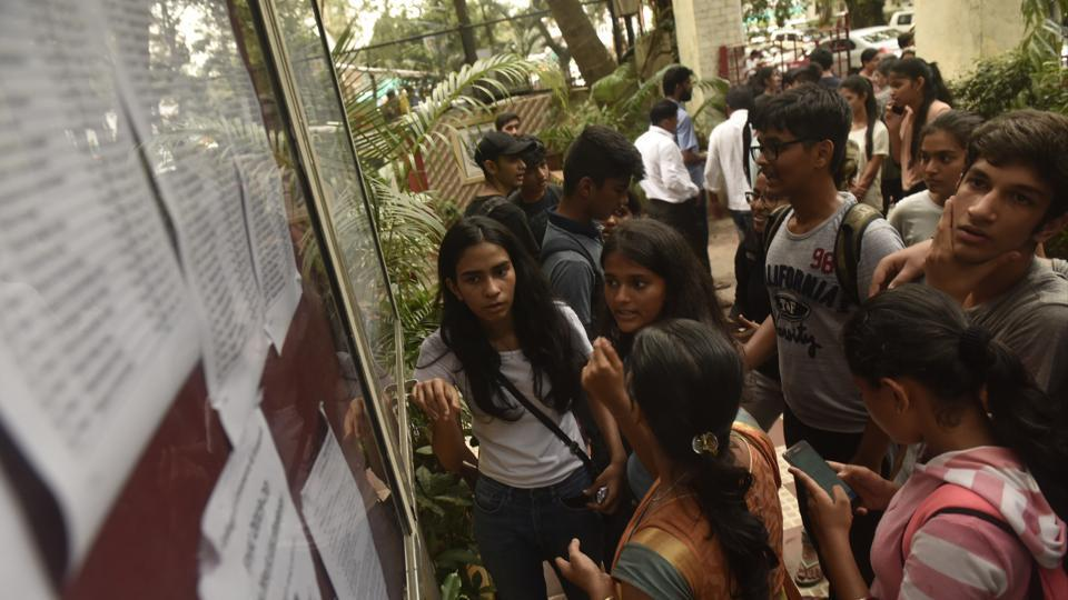 Mumbai, India - July 12, 2019: Students and parents check the first merit list of FYJC, put up outside H R college at Churchgate in Mumbai, India, on Friday, July 12, 2019. (Photo by Anshuman Poyrekar/Hindustan Times)