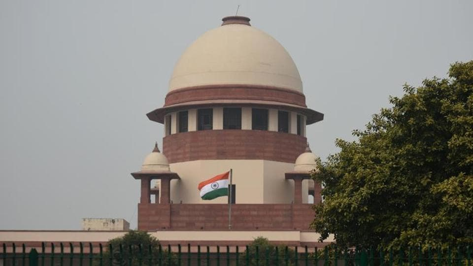 The Supreme Court said that the contest in the open category must be purely on merit.