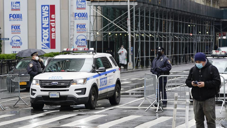 New York Police officers block a street leaving Times Square ahead of the New Year's Celebration Thursday, Dec. 31, 2020, in New York. (AP Photo/Frank Franklin II)