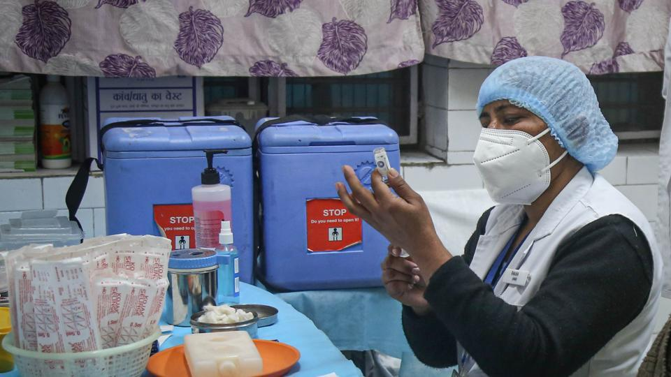 A health worker takes part in a dry run or a mock drill for Covid-19 coronavirus vaccine delivery at a model Covid-19 vaccination centre at Ansari Road in New Delhi.