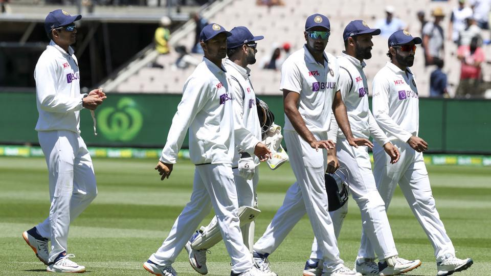 Indian players walk from the field after dismissing Australia for 200 runs in their second innings