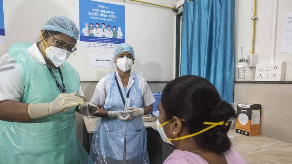 Health workers and candidate during Covid-19 vaccine dry run at District Hospital, Aundh, in Pune.