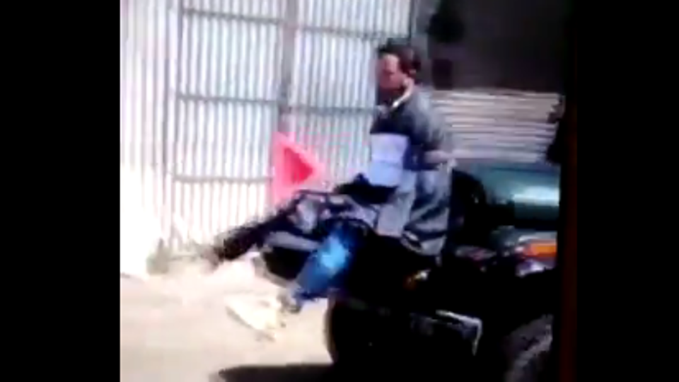 The video shows a man tied to a jeep as a human shield against protesters.