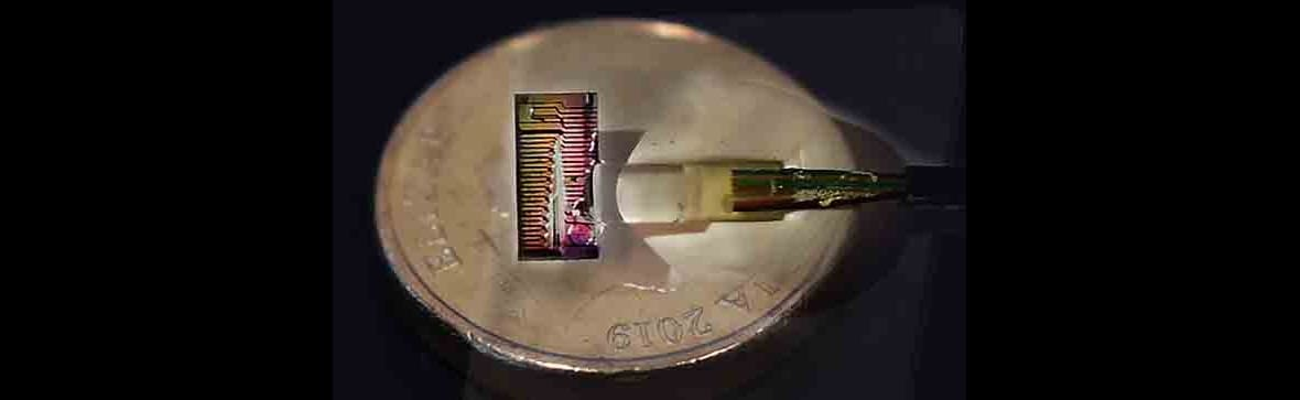 Micro-comb chip  placed next to a normal coin