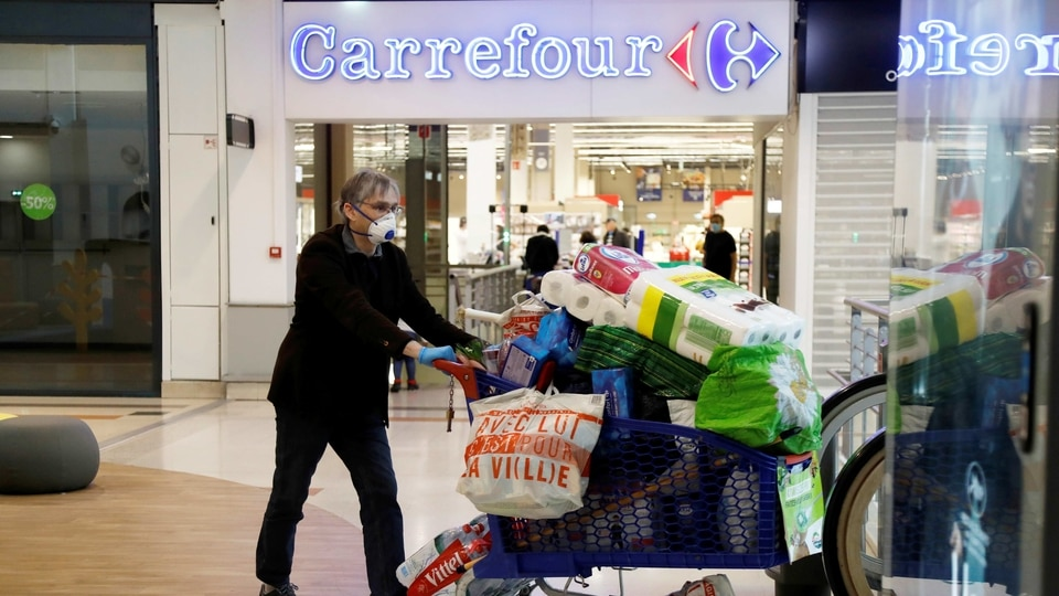 A customer pushes a shopping trolley past a Carrefour hypermaket in a shopping centre in Charenton-le-Pont near Paris during the outbreak of the coronavirus disease (COVID-19) in France