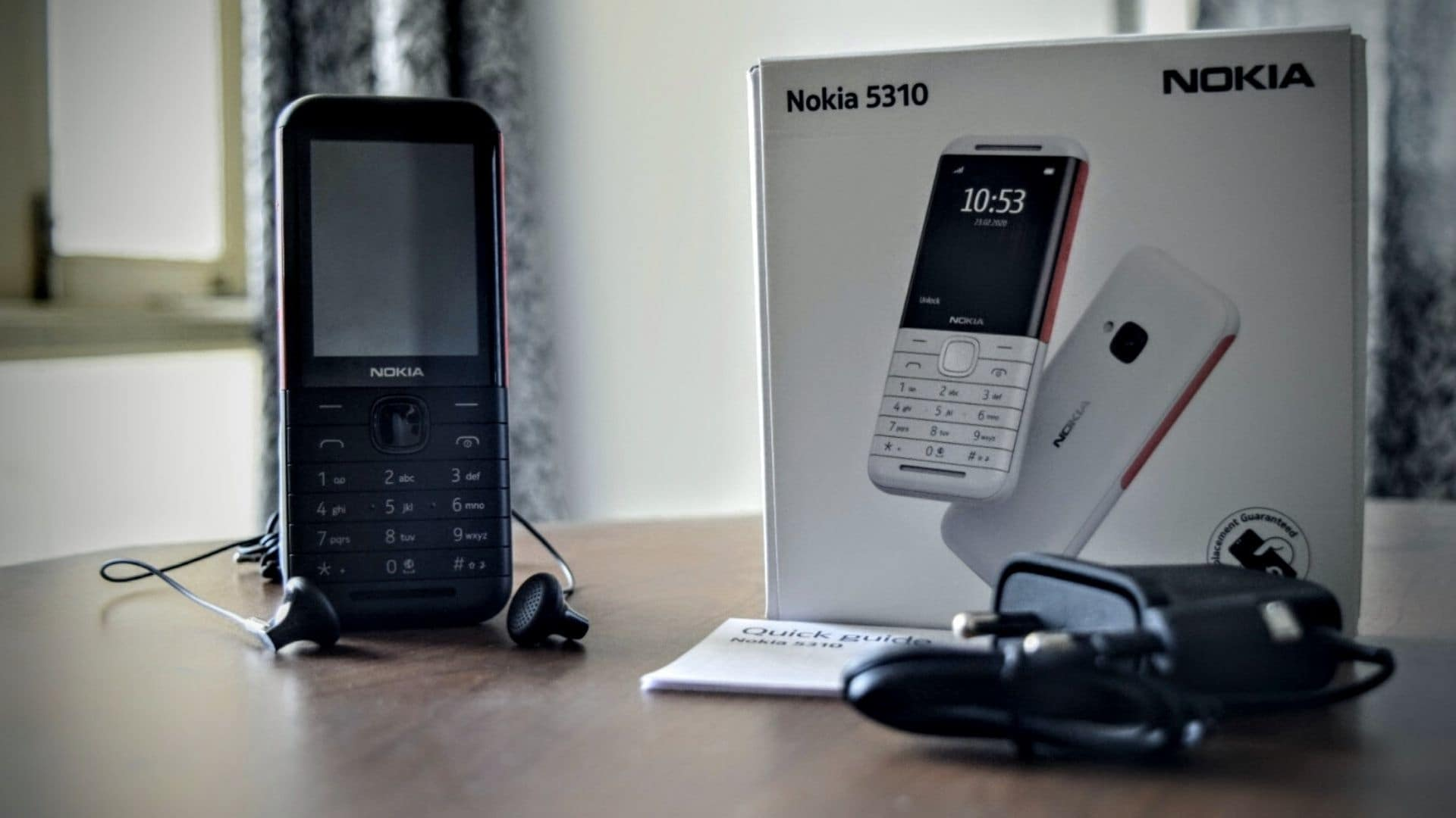 Nokia 5310 is priced at <span class='webrupee'>₹</span>3,399 and it comes in two colour combinations of black/red and white/red.