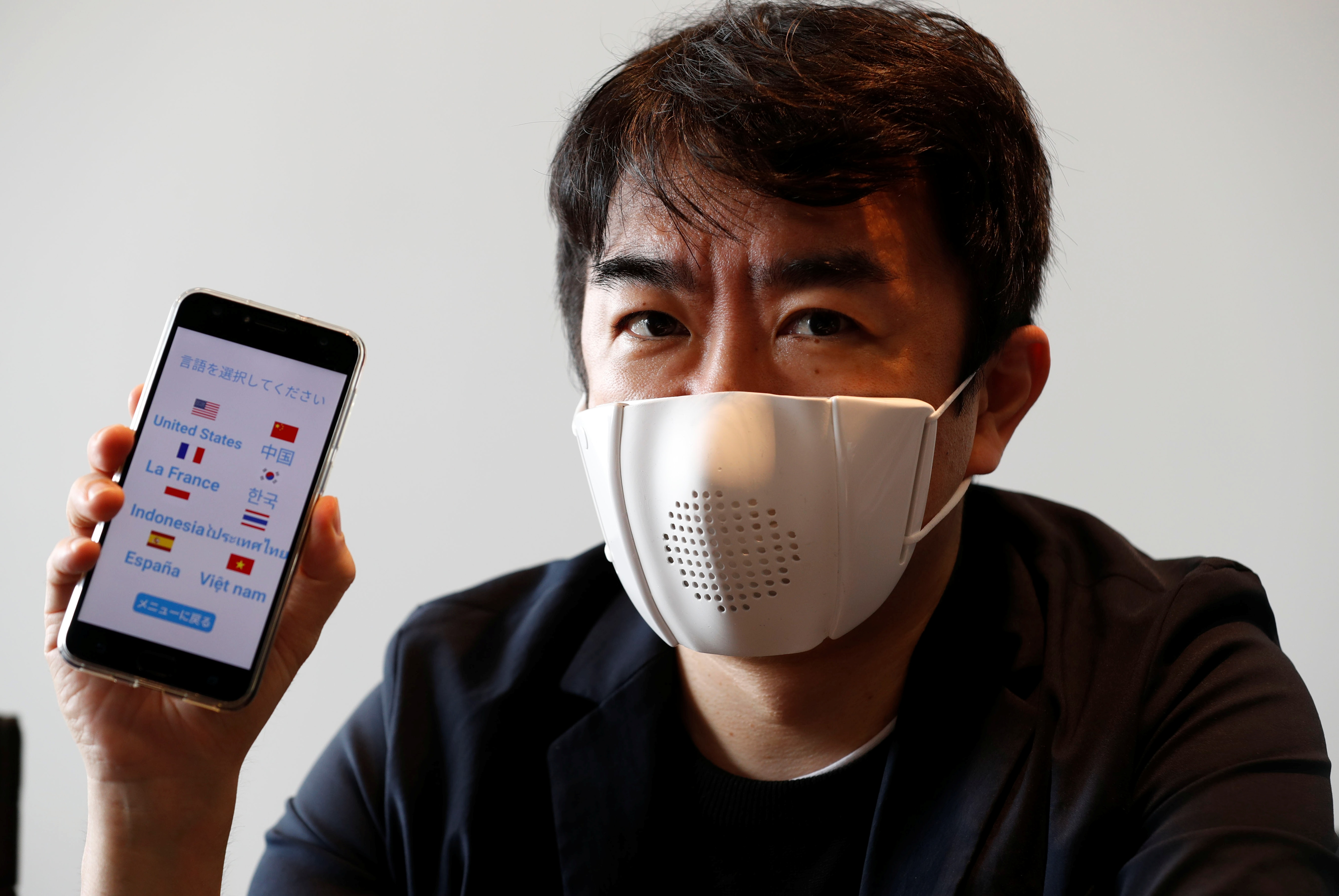 Japanese startup Donut Robotics' CEO Taisuke Ono shows the c-mask and its mobile phone application during a demonstration in Tokyo,