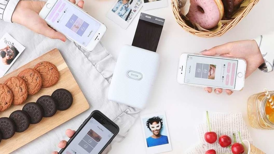 The Instax Mini Link connects with your smartphone over a Bluetooth connection via a dedicated app.