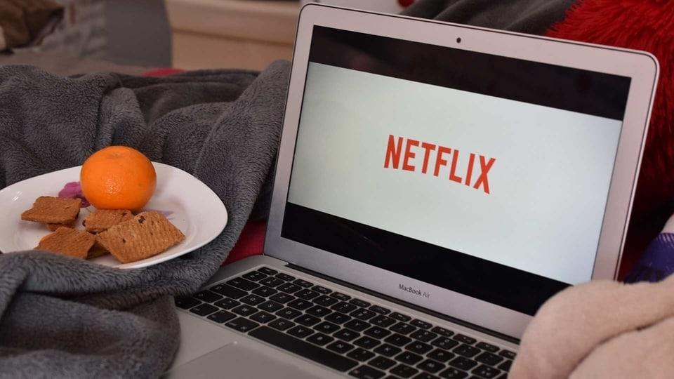 Netflix logo on MacBook.