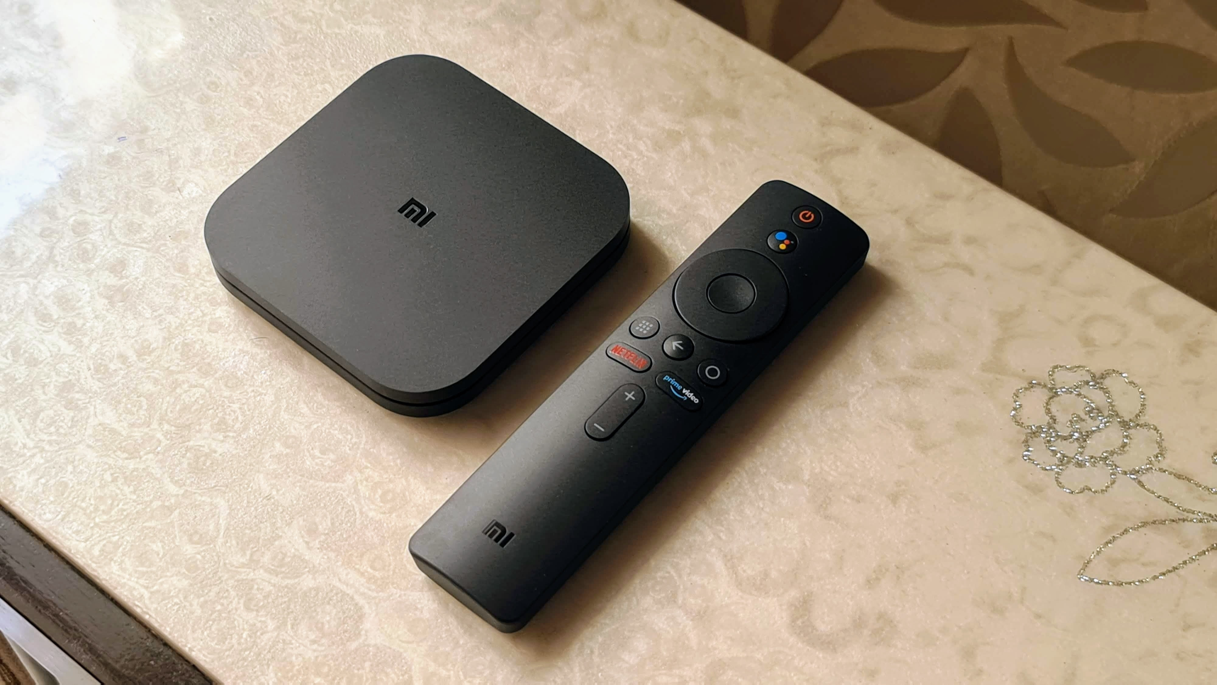 Mi Box 4K along with the remote controller.