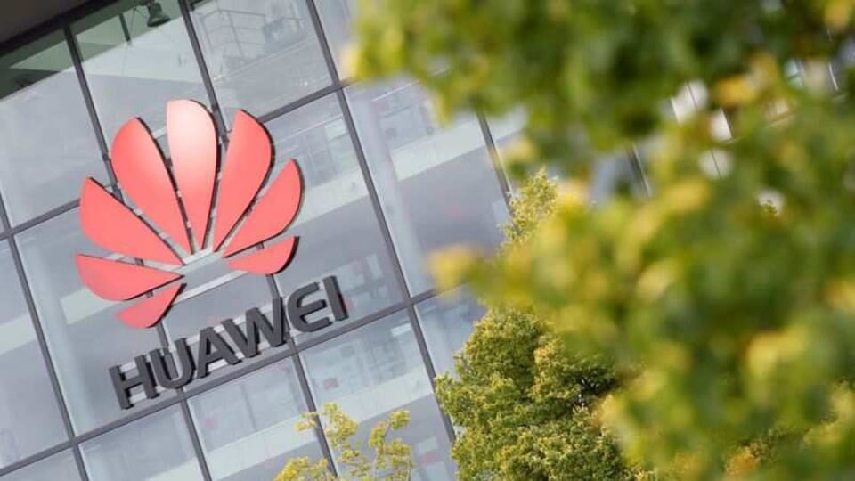 Huawei logo is pictured on the headquarters building in Reading, Britain July 14, 2020.