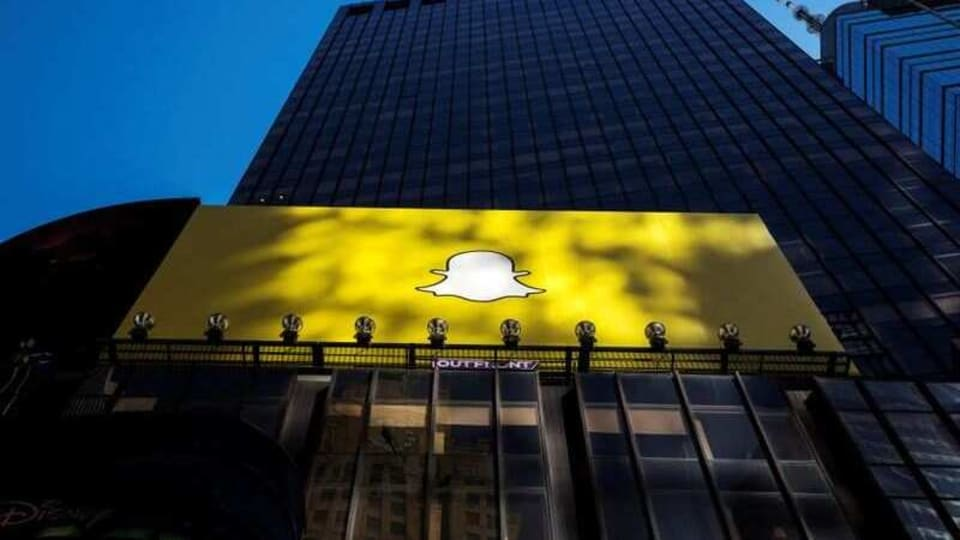 FILE PHOTO: A billboard displays the logo of Snapchat above Times Square in New York March 12, 2015. REUTERS/Lucas Jackson/File Photo