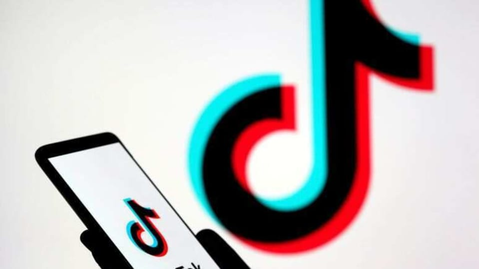 FILE PHOTO: A person holds a smartphone with the TikTok logo displayed in this picture illustration taken Nov. 7, 2019. REUTERS/Dado Ruvic/Illustration/File Photo