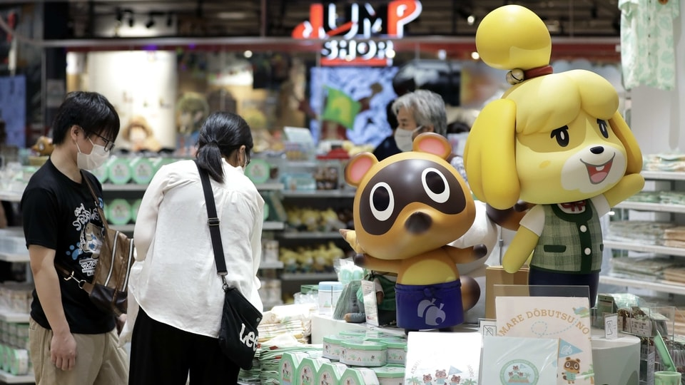 Figurines of the characters Isabelle, right, and Tom Nook from the Nintendo Co. video game Animal Crossing: New Horizons are displayed inside the Nintendo TOKYO store in Tokyo, Japan, on Tuesday, Aug. 4, 2020. Nintendo is scheduled to report first-quarter earnings figures on Aug. 6. Photographer: Kiyoshi Ota/Bloomberg