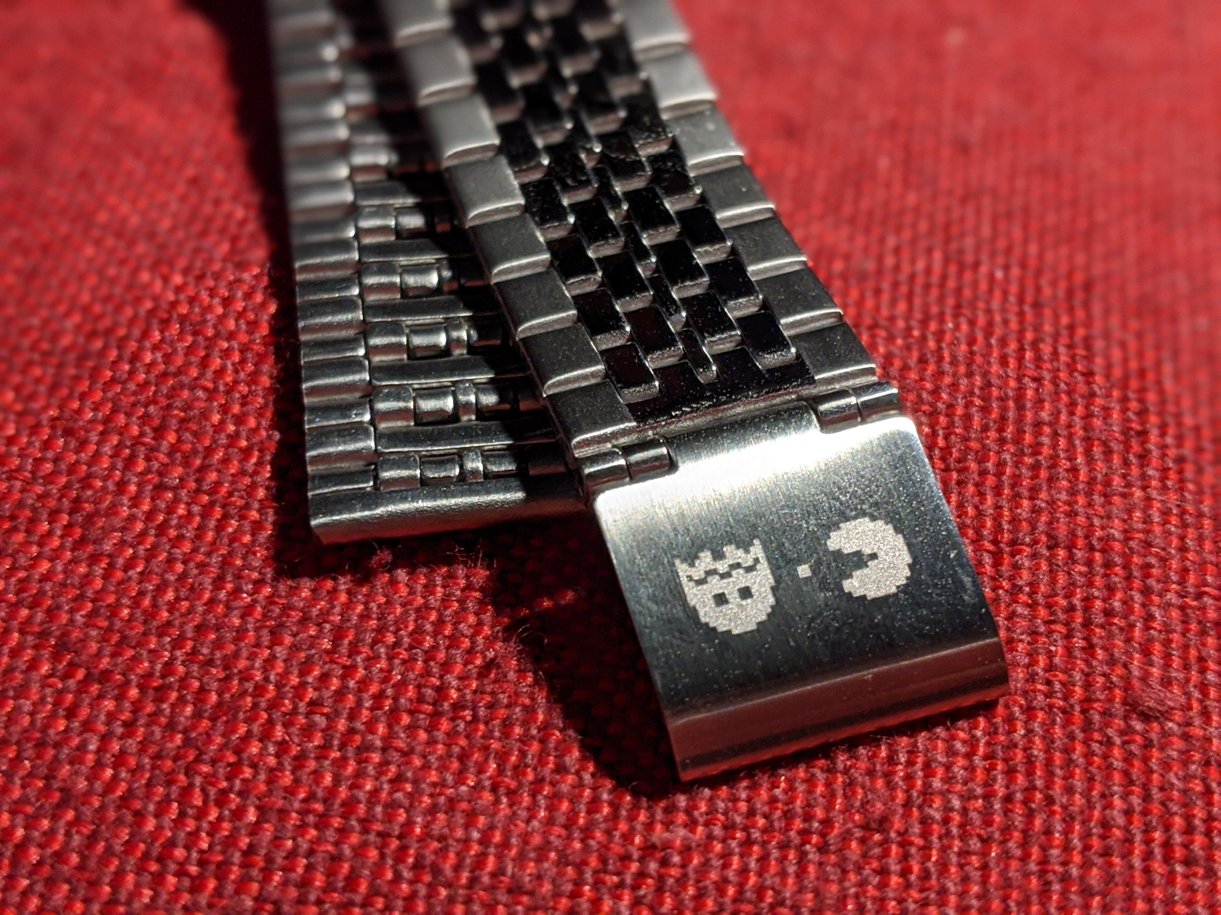 You also get one of the little ghosts, a bit of a video wafer and Pac-Man etched onto the clasp of the watch and on the back of the watch.