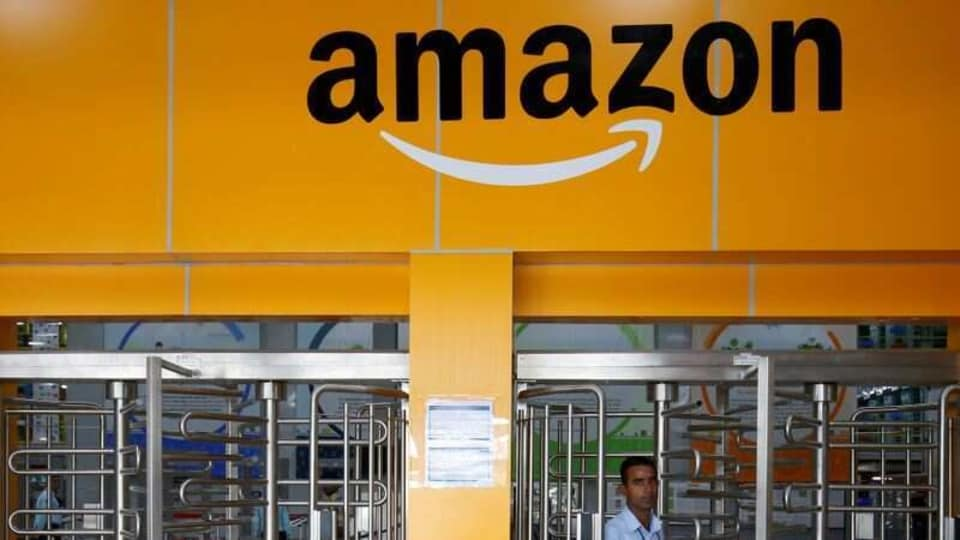 An employee of Amazon walks through a turnstile gate inside an Amazon Fulfillment Centre (BLR7) on the outskirts of Bengaluru, India, September 18, 2018.