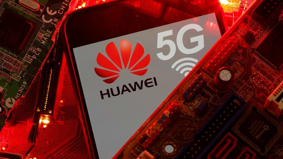 A smartphone with the Huawei and 5G network logo is seen on a PC motherboard in this illustration picture taken January 29, 2020.