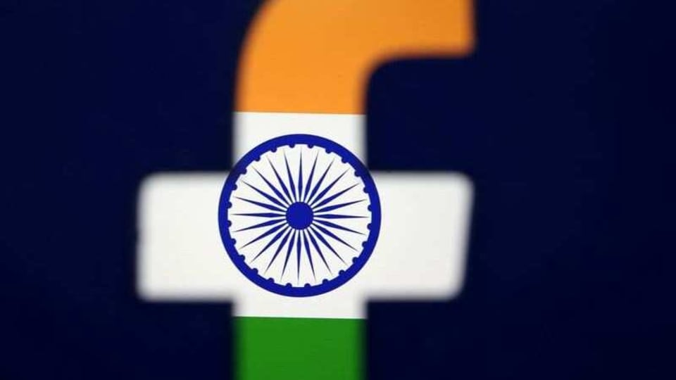 FILE PHOTO: India's flag is seen through a 3D printed Facebook logo in this illustration picture, April 8, 2019. REUTERS/Dado Ruvic/Illustration/File Photo