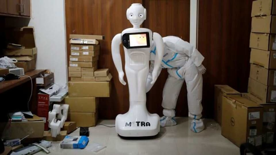 A medical worker puts robot named 'Mitra' , which is used by the patients suffering from the coronavirus disease (Covid-19) to communicate with their relatives, on charge at the Yatharth Super Speciality Hospital in Noida