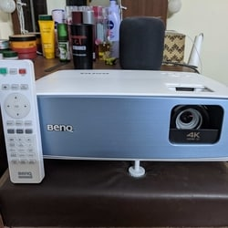 The BenQ TK850 4K projector, with its all-white design and rounded edges, is bulky for sure, but it does not dominate the room. You can place it on pretty much any sturdy, flat surface, adjust the height and you are good to go.