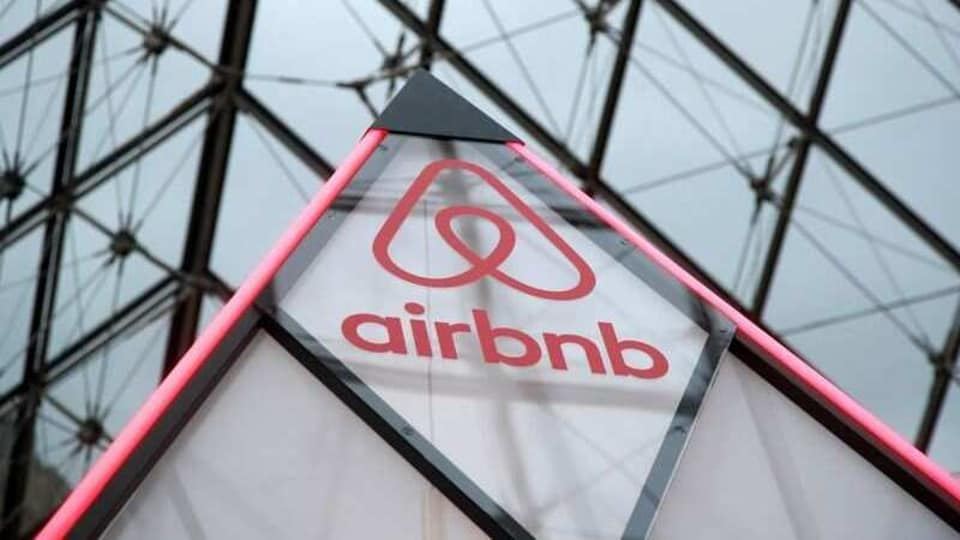 The Airbnb logo is seen on a little mini pyramid under the glass Pyramid of the Louvre museum in Paris, France, March 12, 2019.