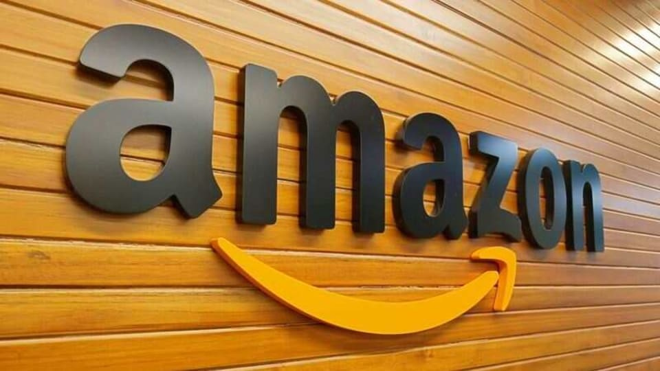 FILE PHOTO: The logo of Amazon is pictured inside the company's office in Bengaluru, India, April 20, 2018. REUTERS/Abhishek N. Chinnappa