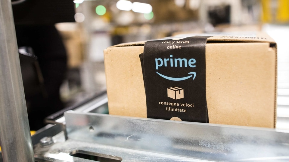 A package sits on a conveyor belt at an Amazon.com Inc. fulfillment center in Kegworth, U.K., on Monday, Oct. 12, 2020. Prime Day, a two-day shopping event Amazon unveiled in 2015 to boost sales during the summer lull, usually occurs in July, but this year got pushed to Oct. 13 in 19 countries, including Brazil, with over 1 million products for sale worldwide. Photographer: Chris Ratcliffe/Bloomberg