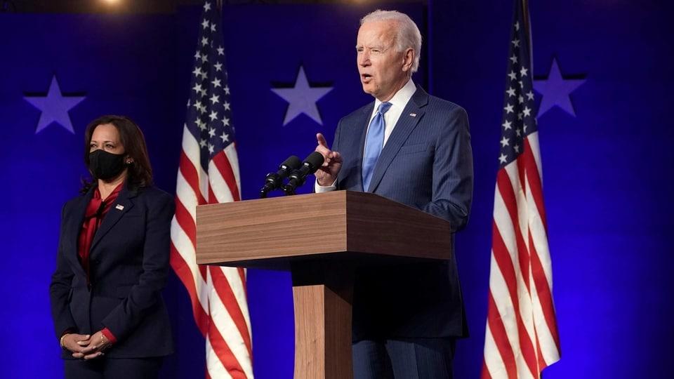 US Democratic presidential nominee Joe Biden speaks about election results next to vice presidential nominee Kamala Harris in Wilmington, Delaware.