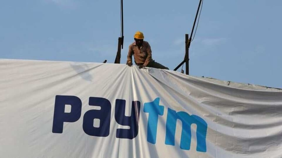 A worker adjusts a hoarding of Paytm, a digital payments firm, in Ahmedabad, India, January 31, 2019. REUTERS/Amit Dave/Files