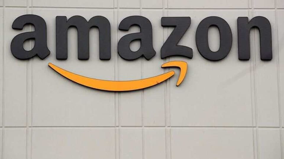 FILE PHOTO: The Amazon logo is pictured outside the company's JFK8 distribution center in Staten Island, New York, U.S. November 25, 2020. REUTERS/Brendan McDermid/File Photo
