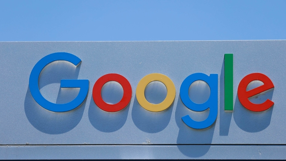 FILE PHOTO: After the company announced it would extend its coronavirus work-from-home order until summer 2021, a Google sign is shown at one of the company's office complexes in Irvine, California, U.S., July 27, 2020. REUTERS/Mike Blake/File Photo