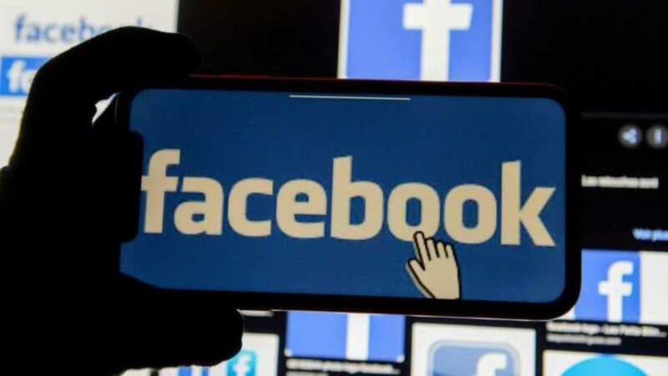 FILE PHOTO: The Facebook logo is displayed on a mobile phone in this picture illustration taken December 2, 2019. REUTERS/Johanna Geron/Illustration/File Photo