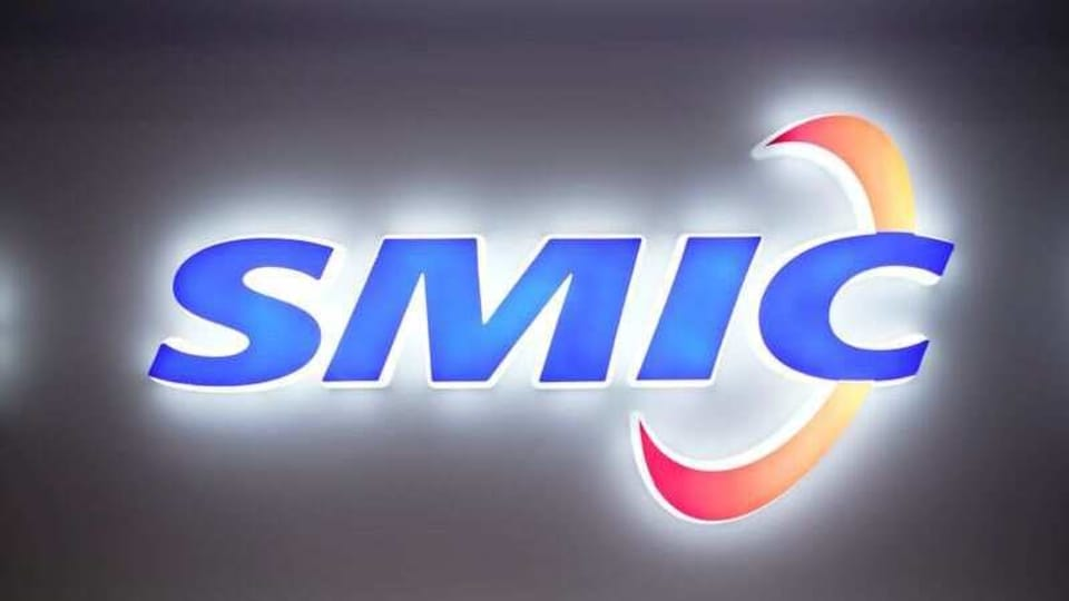 FILE PHOTO: A logo of Semiconductor Manufacturing International Corporation (SMIC) is seen at China International Semiconductor Expo (IC China 2020). REUTERS/Aly Song/File Photo