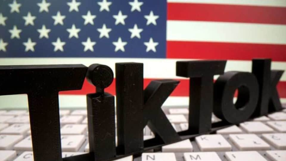 FILE PHOTO: A 3D printed TikTok logo is placed on a keyboard in front of U.S. flag in this illustration taken October 6, 2020. REUTERS/Dado Ruvic/Illustration/File Photo