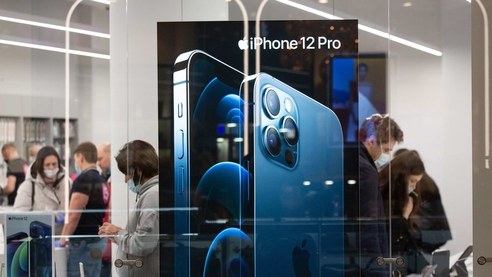 An iPhone 12 Pro display in the window of an Apple Inc. store at the Aviapark shopping center, Russia's largest shopping mall, in the Khoroshyovsky District of Moscow, Russia, on Friday, Nov. 27, 2020. A worsening Covid-19 outbreak is threatening Russia's economy with another contraction, after a swifter-than-expected rebound in 3Q. Photographer: Andrey Rudakov/Bloomberg