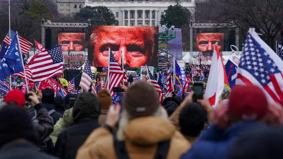 In this January 6, 2021, file photo, Trump supporters participate in a rally in Washington. Far-right social media users for weeks openly hinted in widely shared posts that chaos would erupt at the US Capitol while Congress convened to certify the election results.